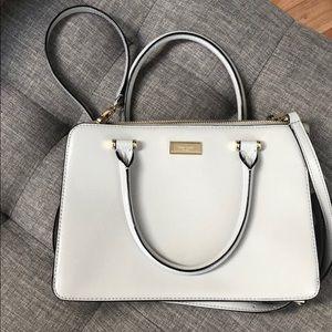 Light grey patent leather Kate Spade handbag